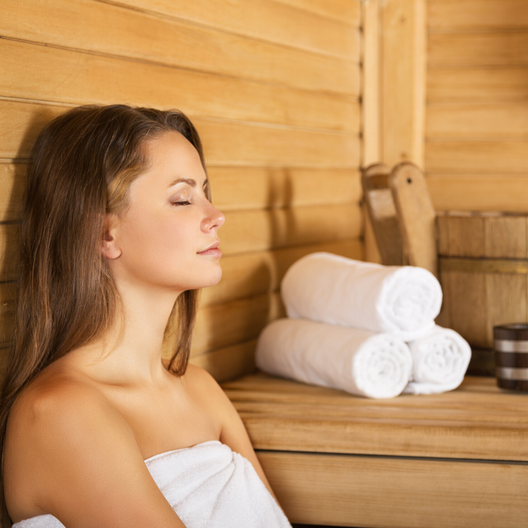 woman enjoying her home sauna with sauna accessories from Saunafin