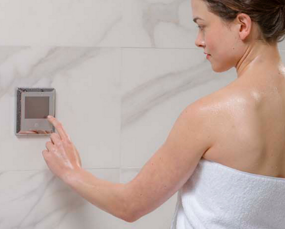 Woman adjusting Steamist Steam Shower settings